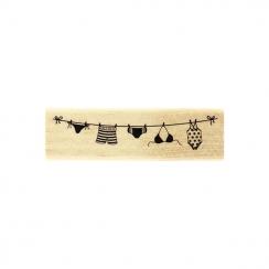 Tampon bois SUR LE FIL par Florilèges Design. Scrapbooking et loisirs créatifs. Livraison rapide et cadeau dans chaque commande.
